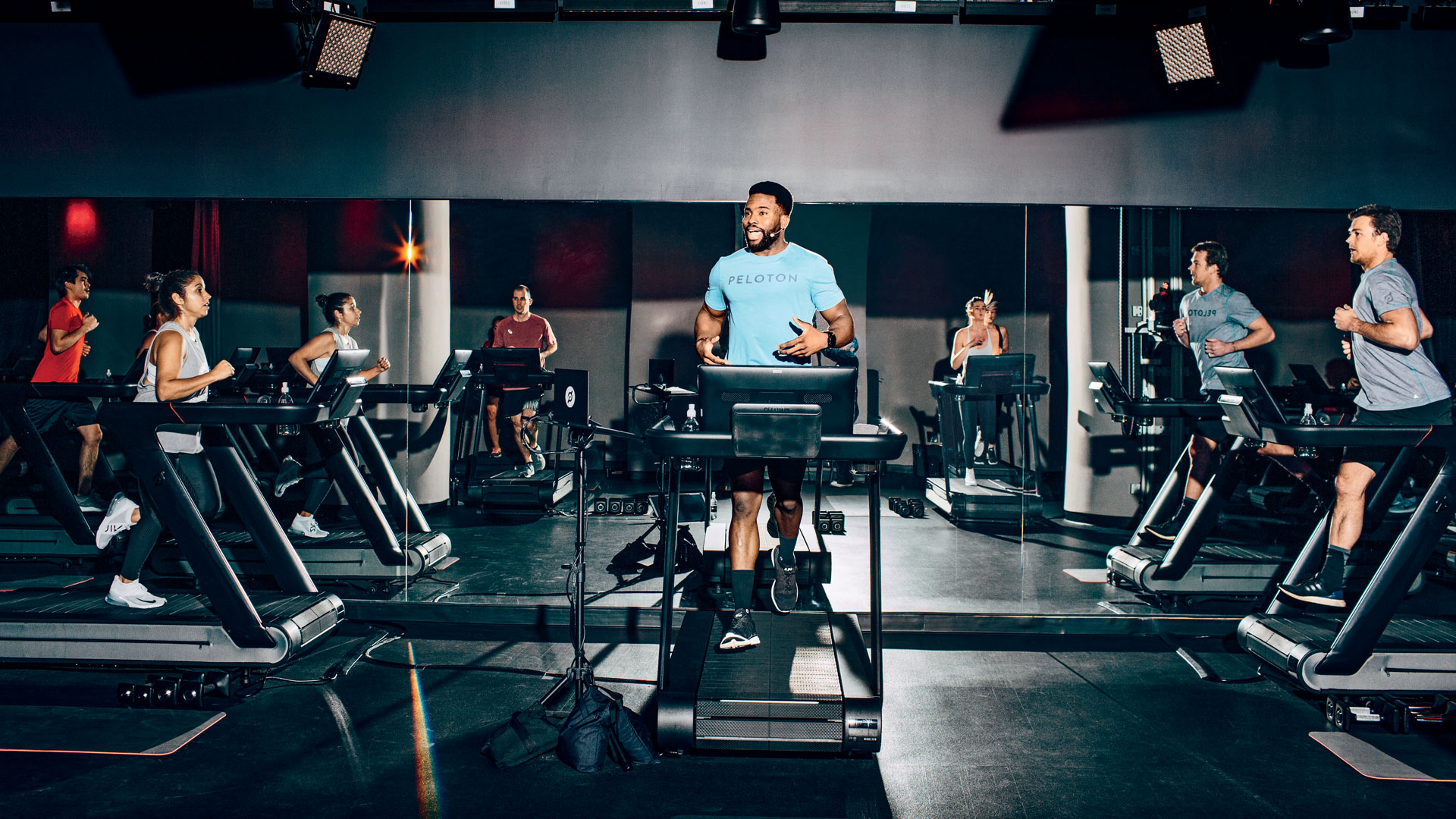 """<p><b style="""""""">Chase Tucker </b>leads a live boot camp class at Peloton's West Village studio in New York City.</p>"""