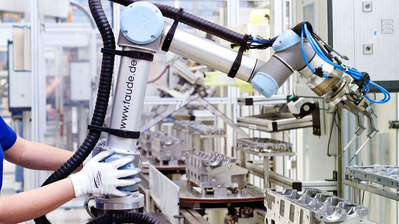 At Volkswagen, Robots Are Coming Out Of Their Cages