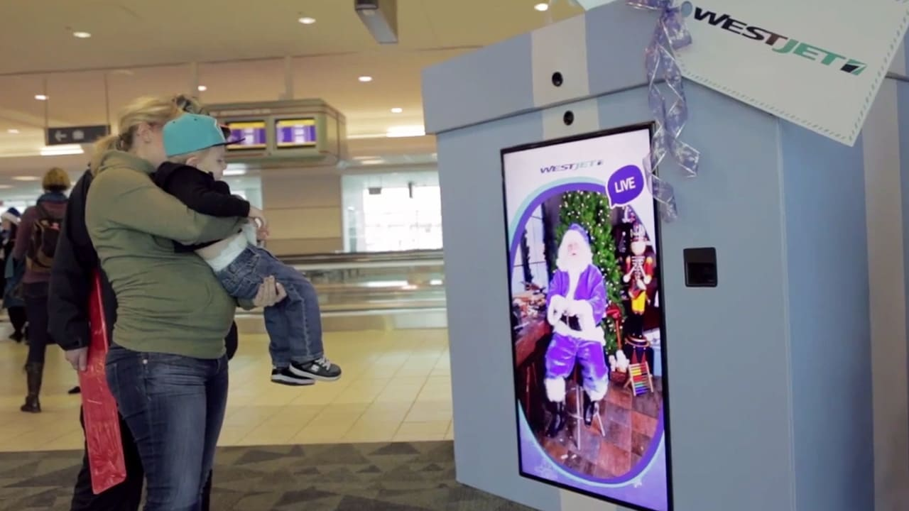 Here's How Westjet Helped Santa Actually Deliver Presents To Unsuspecting Airline Passengers
