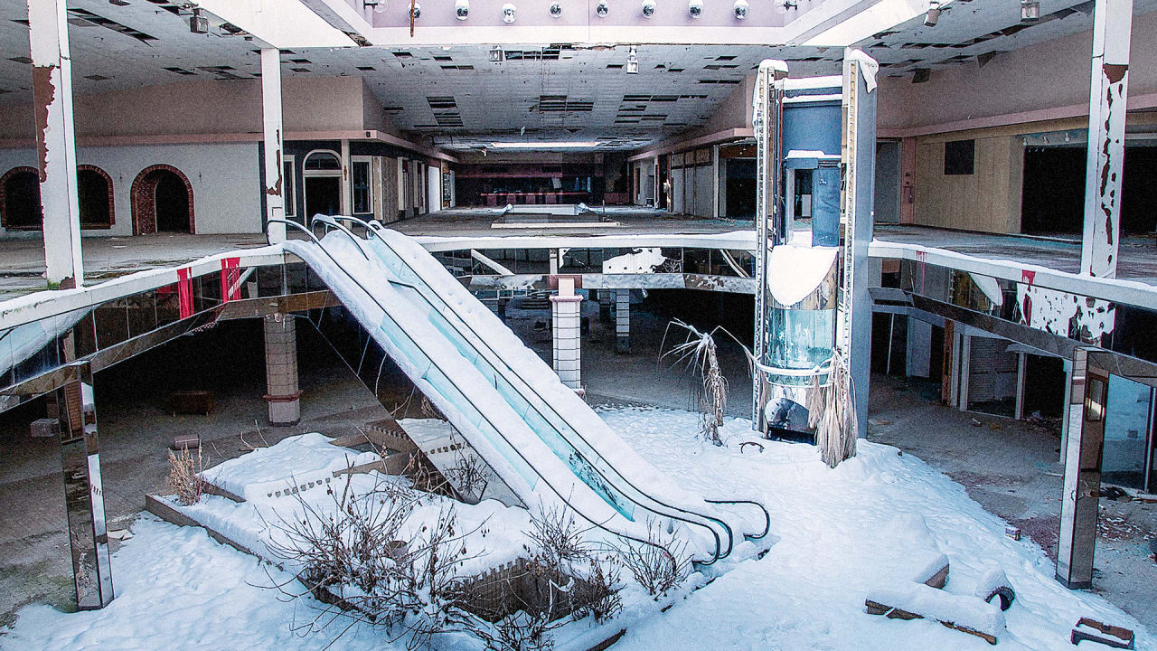 Surreal Photos Of Abandoned, Snow-Filled Malls Show The Death Of An Era In America