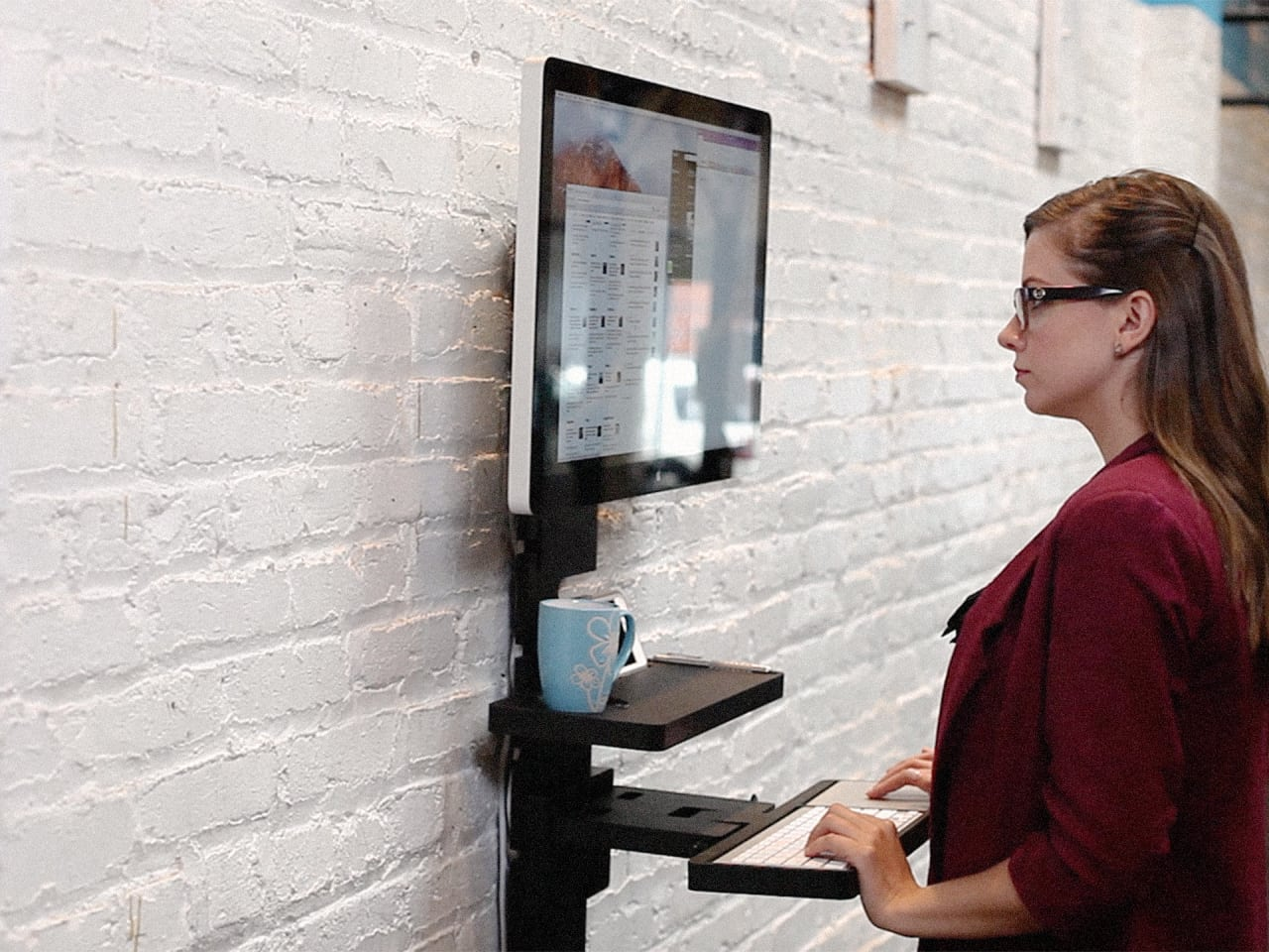 This Wall-Mounted Standing Desk Is Perfect For Coffee Shops And Shared Offices