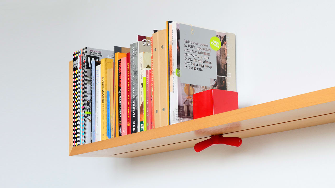 Wall Mounted Shelf Prevents Toppling Books With Sliding Lock