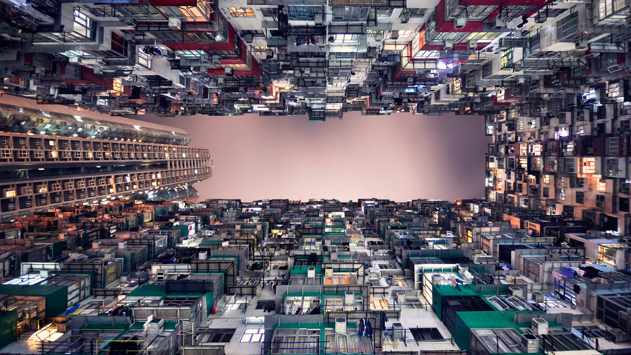 Views Of The Hong Kong Sky, Framed By A Canopy Of Skyscrapers