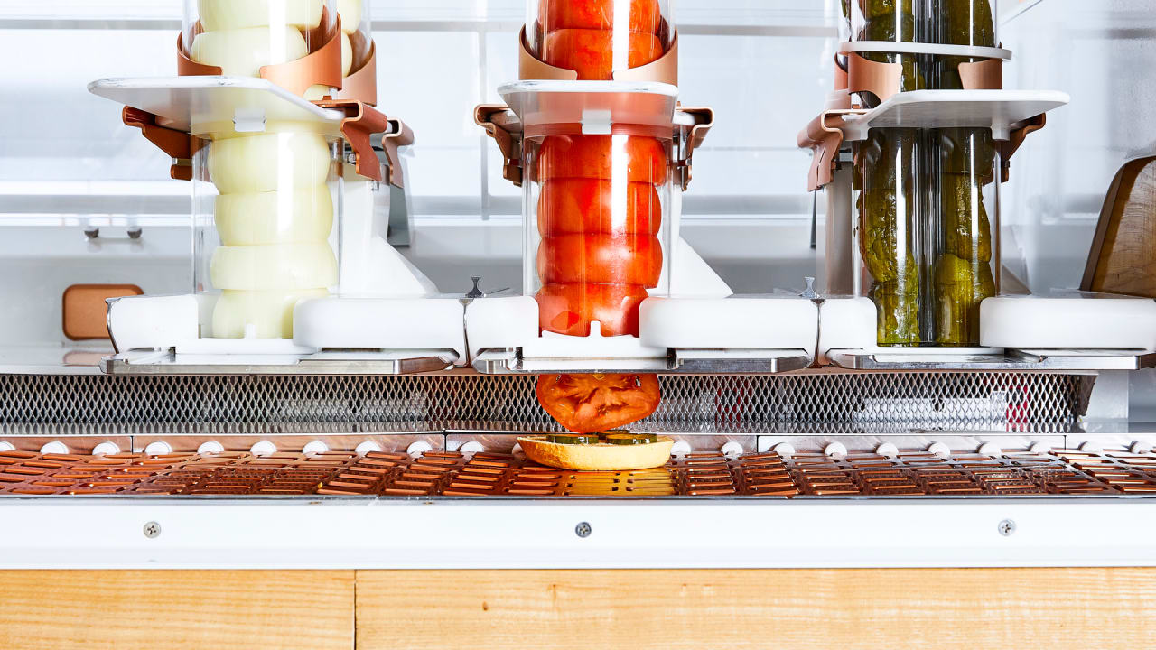 this crazy looking robot is the chef at a new burger joint