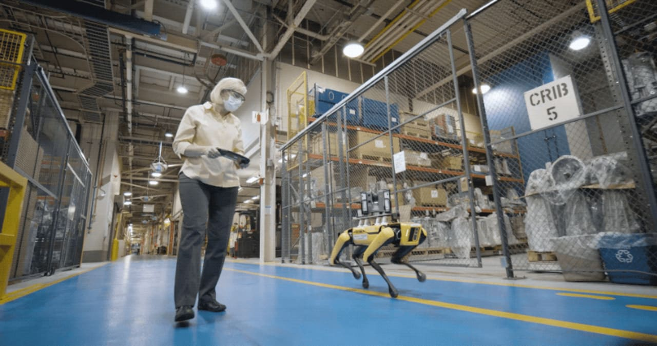 At Ford factories, Boston Dynamics's robot dog Spot is teaming up with a new robotic friend