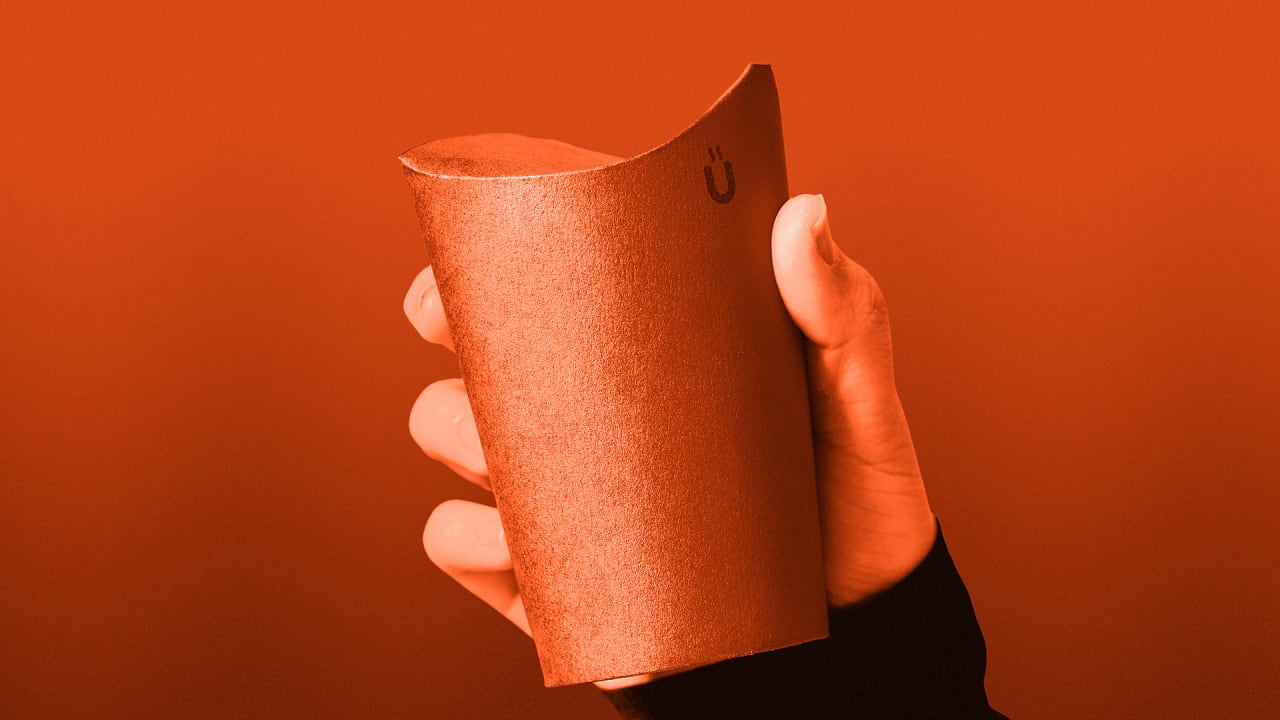 This folding coffee cup eliminates the need for a plastic lid