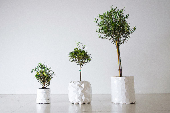 this origami pot grows along with a plant s roots. Black Bedroom Furniture Sets. Home Design Ideas