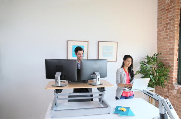 This Desk Goes From Sit To Stand With A Flick Of The Wrist
