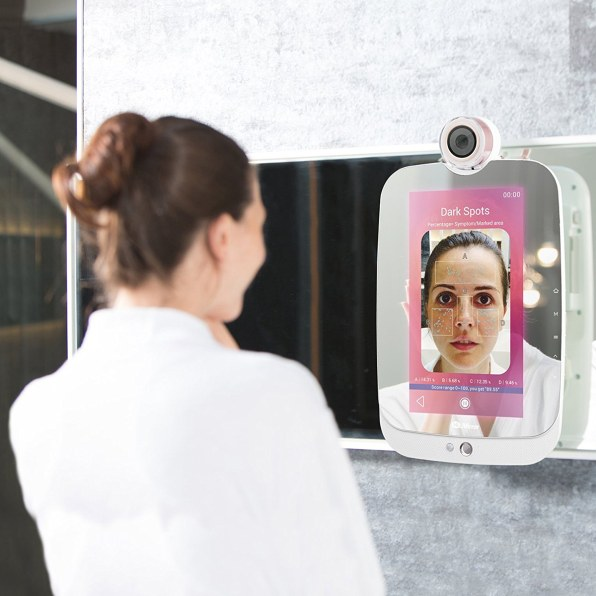 The new himirror 189 acts as a daily beauty consultant a camera that sits on top of it closes in on your face and analyzes your skins wrinkles