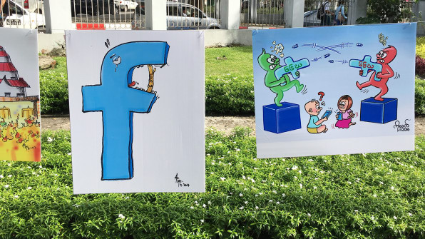 Jailed For A Facebook Poem The Fight Against Myanmars Draconian Defa - Cartoon mural man obsessing facebook likes says lot society