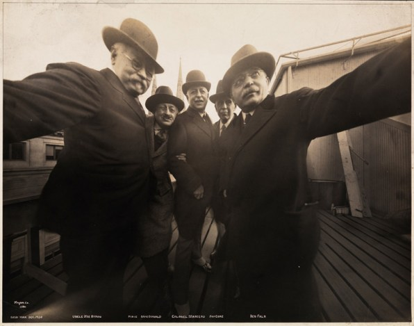 A black and white photo of the Five Men (1920) as a selfie with an old fashioned camera