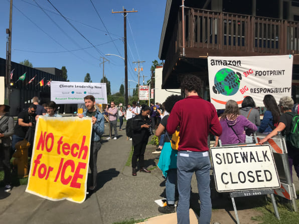 Activists made demands outside the shareholder meeting [Photo: Alex Pasternack